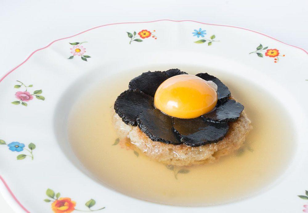 Ravioli di pesce con seppie al suo nero